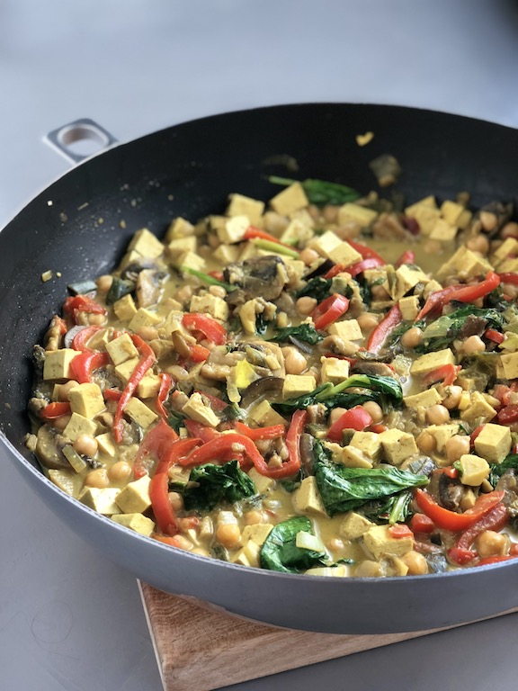 Chickpea Coconut Curry with Tofu, vegan, plantbased, in a wok