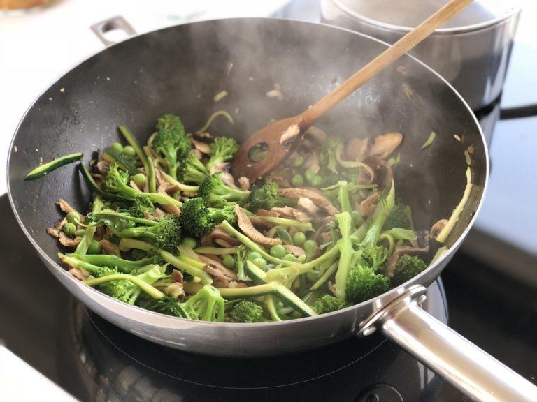 Greens roasting in wok