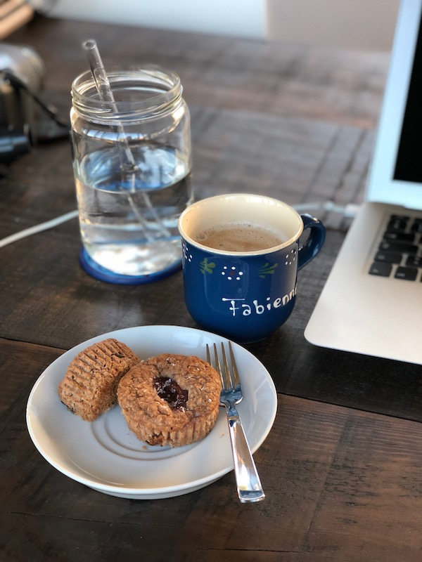 Cinnamon-Plum-Cake Muffins on white plate with coffee and glass of water