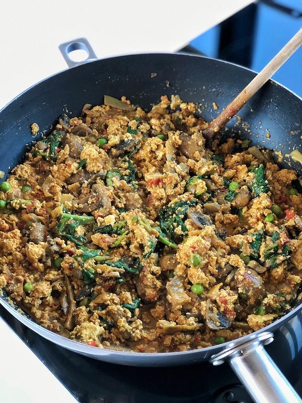 Scrambled tofu with veggies in a wok