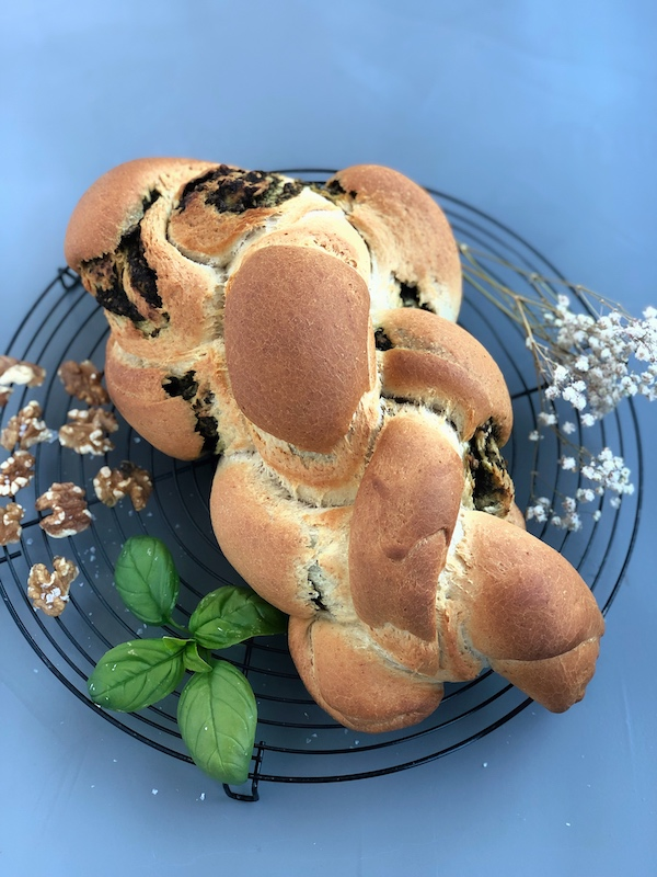 Braided Bread with Superfood Pesto with walnuts and basil leaves