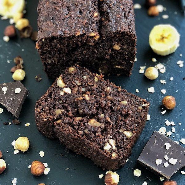 Chocolate Banana Bread with toasted hazelnuts on black slate