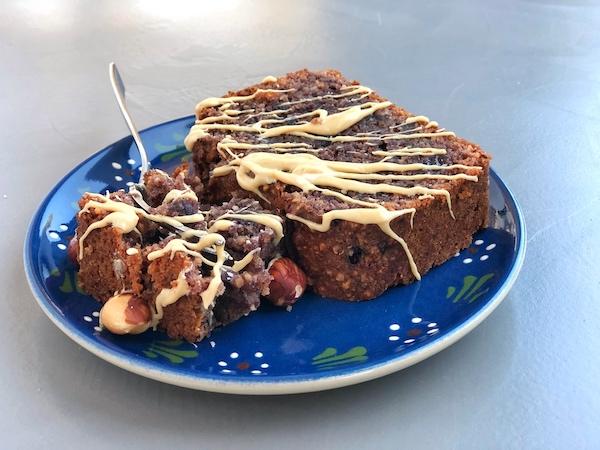 Jam Cake with roasted hazelnuts on blue plate