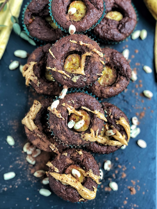 Peanut Butter filled Chocolate Banana Muffins, vegan, on black slate