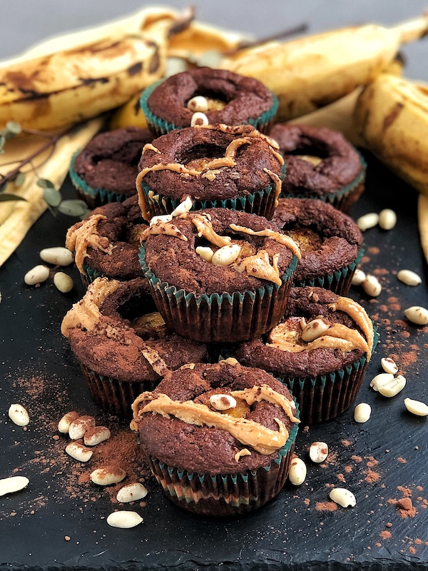 Peanut Butter filled Chocolate Banana Muffins, vegan, on black slate