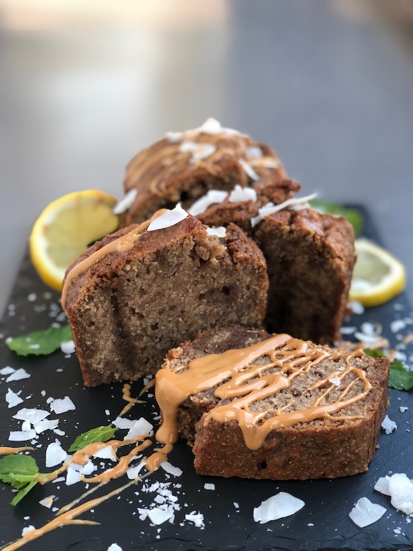 Vegan Lemony Ice Tea Cake with Cashew Butter Drizzle on black slate